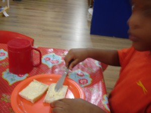 We demonstrate our independence skills at mealtimes.